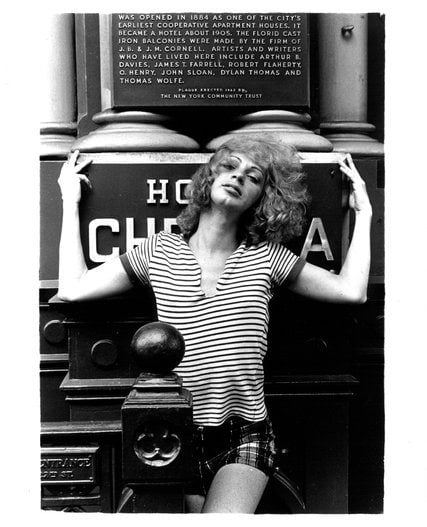 Holly Woodlawn in front of the Chelsea Hotel - Photo by Gerard Malanga