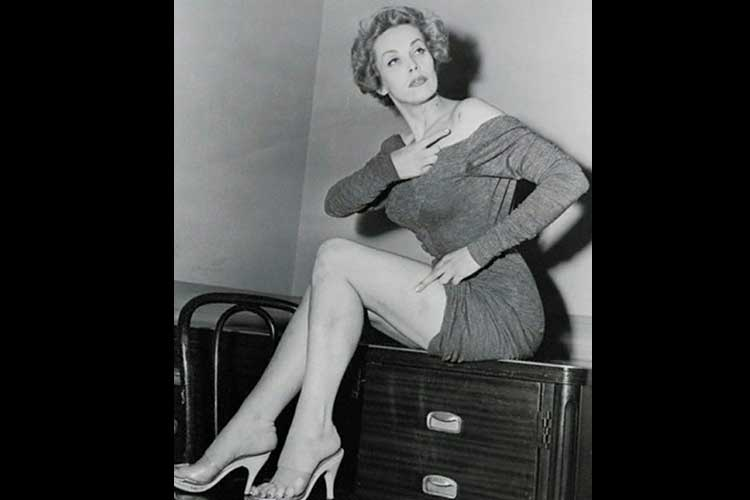 Photo of Maila pointing to bruises after burglary and attempted rape, in December, or January, 1956.