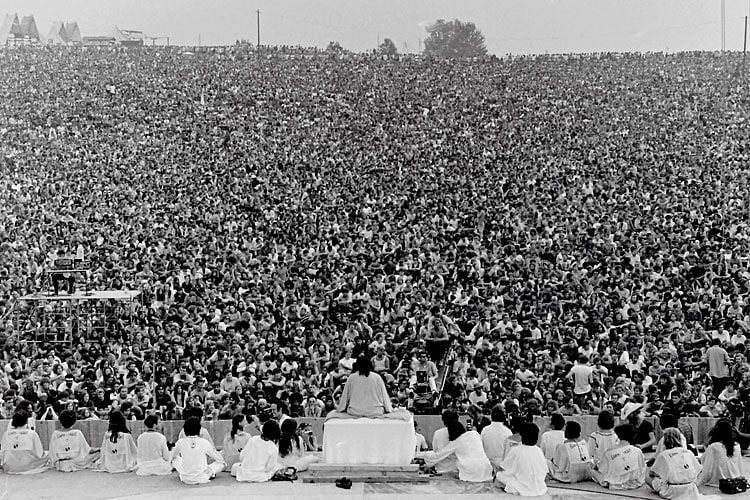 Swami Satchidananda at the Woodstock-Opening Ceremony - By Mark Goff Public domain], via Wikimedia Commons
