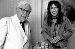 Alice Cooper meets Colonel Sanders of Kentucky Fried Chicken in Amsterdam while they were both at the same hotel doing PR in 1974, By Barry Schultz.