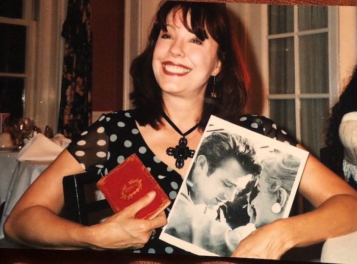 Pamela holding pic of the day Toni walked to Jimmy at Googies