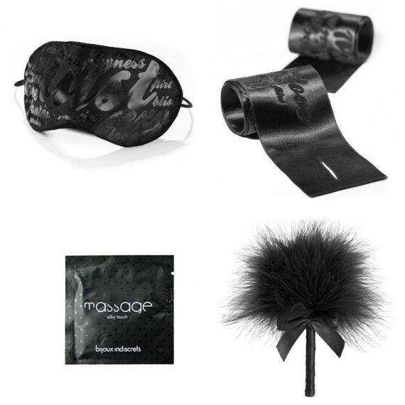 Bijoux Indiscrets set including a satin eye mask, satin wrist restraints, feather tickler and massage gel