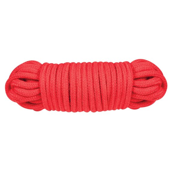 Ten metres of red cotton bondage and shibari rope in a tight coil