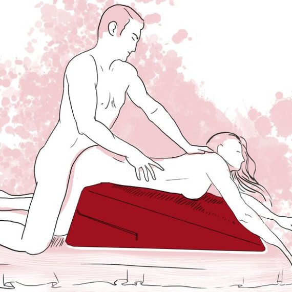 A sketch of a naked woman lying on her front on the Liberator Ramp sex position aid having sex with a naked man who is kneeling behind her with his hands on her back and neck