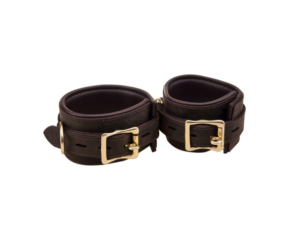 A pair of Bound Nubuck Leather wristcuffs with large brass buckles