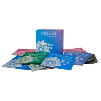 Sliquid Naturals Lube Cube surrounded by a pile of pillow sachets of lube