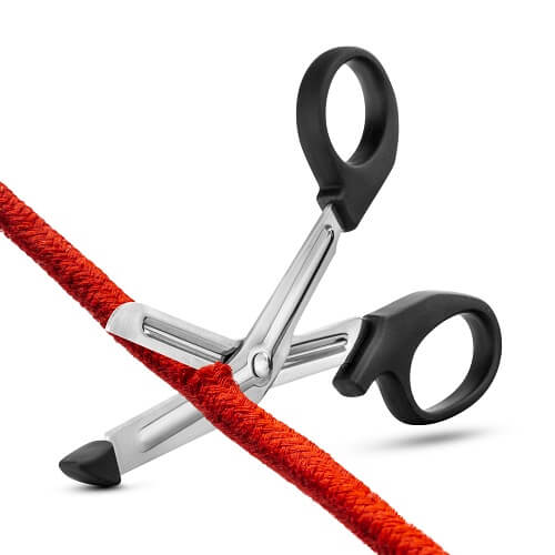 A pair of safety scissors cutting through a red rope
