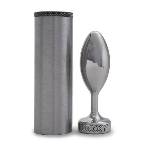 A Doxy Butt Plug Smooth next to its metal storage case