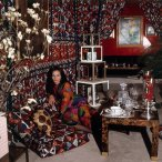 diane-von-furstenberg-fashion-designerprincess-sitting-with-folded-arms-in-her-new-york-apartment-in-a-hallway-draped-with-javanese-print-fabric-vogue-1972-horst-p-horst