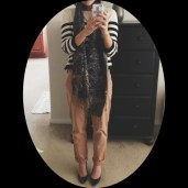 Striped breton top with khakis, long scarf, and patent black pumps.