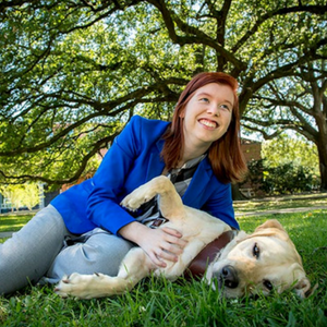 Guide dog goes with grad every step of the way