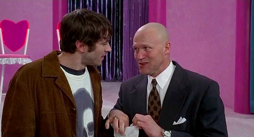 Jason Lee como Brodie Bruce y Michael Rooker como Jared Svenning en Mallrats (1995). Imagen: IMDb.com