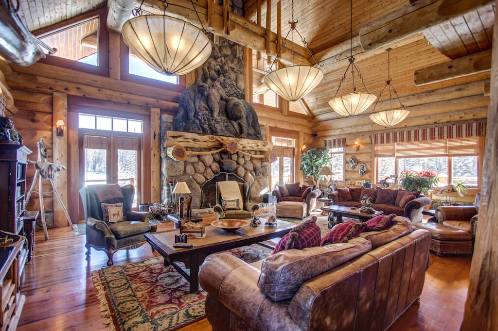 Great-room-timber-river-rock-stone-fireplace-mansion-352248-Pine-Ridge-Road-Bragg-Creek-Ranch-Acreage-For-Sale-Calgary-Real-Estate-For-Sale-taylor-sothebys-Realtor-Plintz