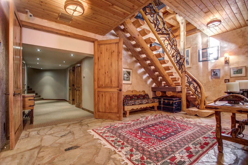 Walkout-basement-log-staircase-352248-Pine-Ridge-Road-Bragg-Creek-Ranch-Acreage-For-Sale-Calgary-Real-Estate-For-Sale-taylor-sothebys-Realtor-Plintz