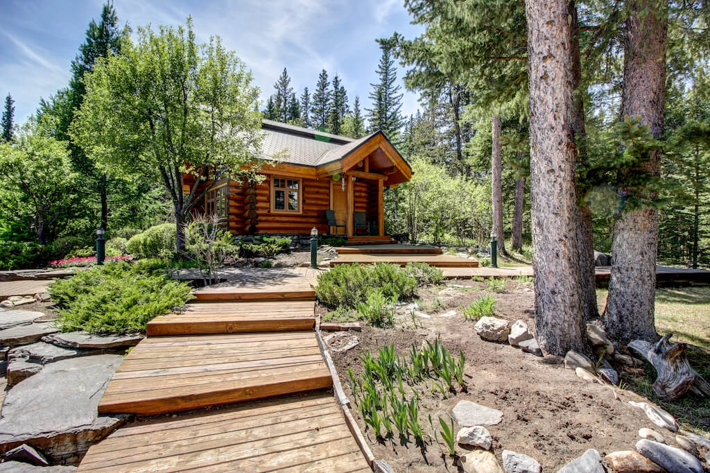 Guest-cabin-realtor-352248-Pine-Ridge-Road-Bragg-Creek-Ranch-Acreage-For-Sale-Calgary-Real-Estate-For-Sale-taylor-sothebys-pond-log-frame