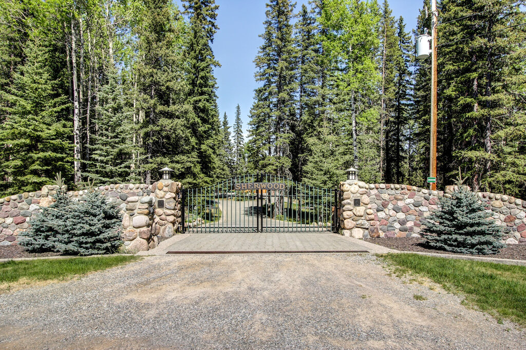 Sherwood-ranch-gate-Realtor-352248-Pine-Ridge-Road-Bragg-Creek-Ranch-Acreage-For-Sale-Calgary-Real-Estate-For-Sale-taylor-sothebys-pond