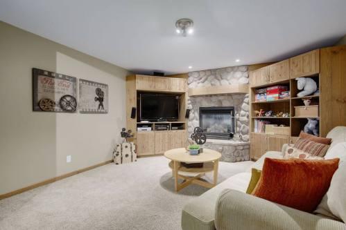 river-stone-built-in-media-centre-open-beam-303-Valley-Crest-Court-NW-Valley-Ridge-Plintz-Real-Estate-For-Sale-Calgary-Alberta