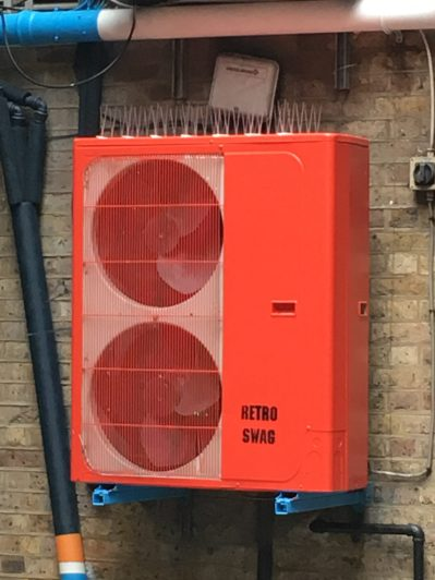 Irrational close up of a brightly coloured A/C unit.
