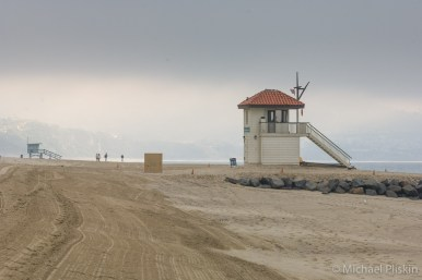 Lifeguard towers on Redondo Beach on a hazy day
