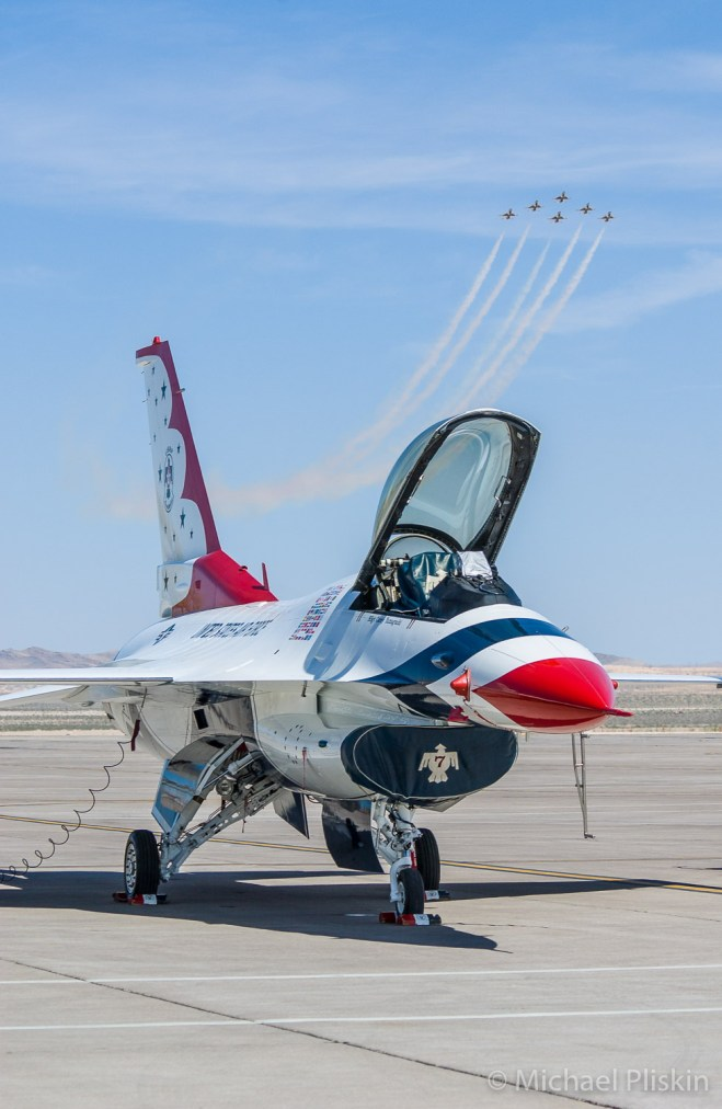 US Air Force Thunderbirds flight demonstration team flying F-16 Falcons in practice at Nellis AFB in Nevada.