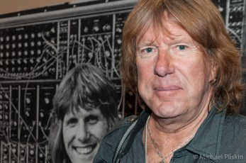 Keith Emerson with a photo of the younger version of himself at the Moog Synthesizer booth at NAMM 2015