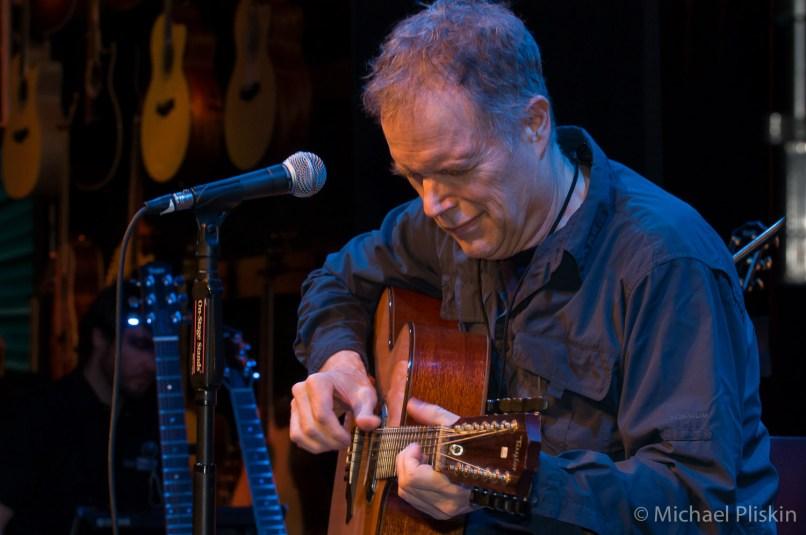 Leo Kottke plays a 12-string guitar at Taylor's room at NAMM 09