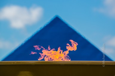Special Olympics Flame in front of the Cal State Long Beach blue pyramid.