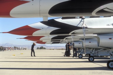 Flight crew prepares USAF Thunderbirds for an air show.