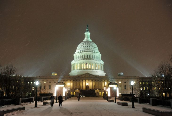 Snow falls on the U.S. Capitol Building