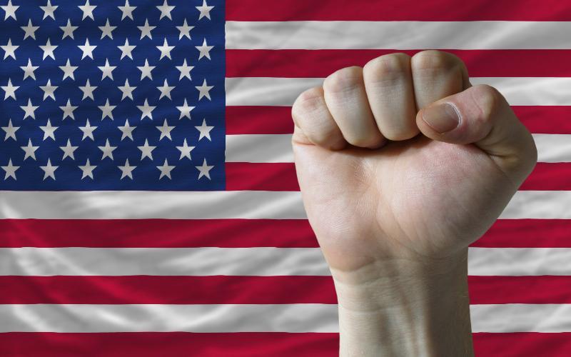 fist and u.s. flag