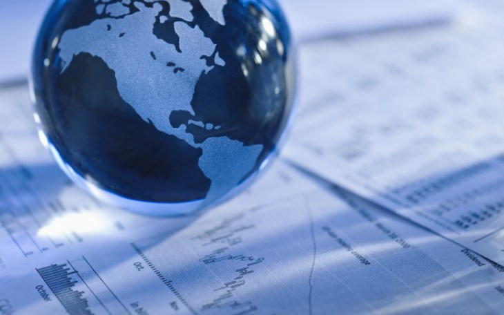 Globe over financial data sheets