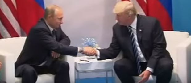 Trump and Putin shake hands at G20