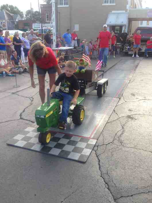 Street fair pedal tractor pull.  Another award!