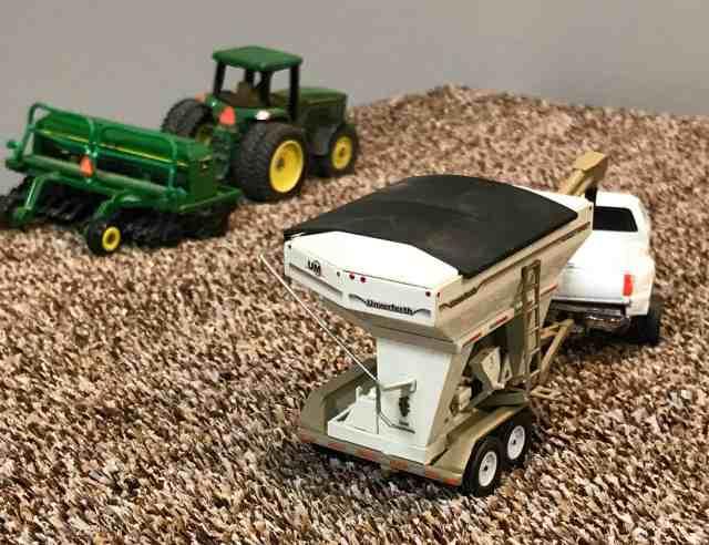 farm toy seed tender in planting scene