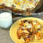 Sausage Pizza Bubble Up casserole on a plate next to dish