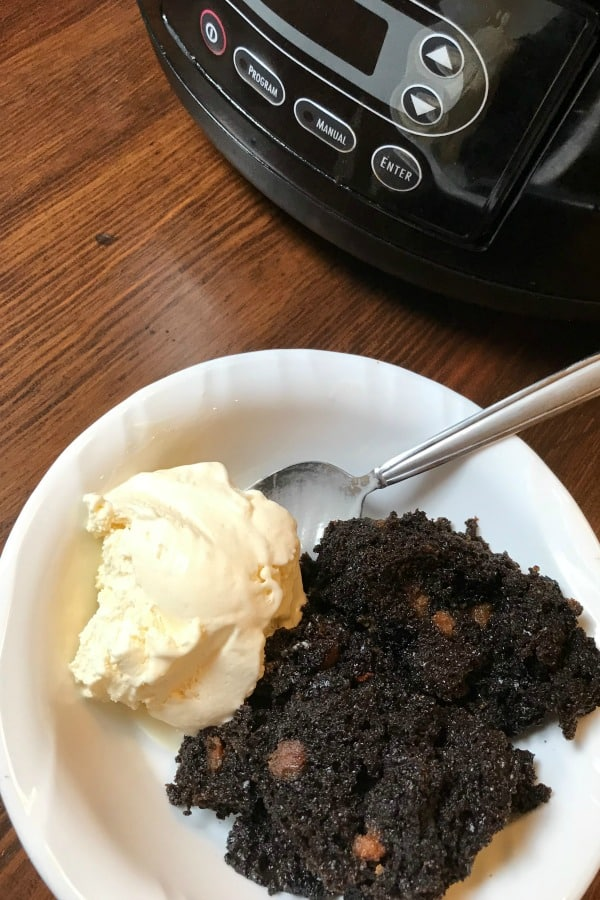 easy crock pot cake is a simple dessert idea that takes 10 minutes to mix up and cooks on low for 5 hours. Serve warm with ice cream and enjoy!