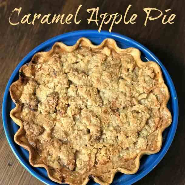 Do you love dipping apples in caramel?  Then you'll LOVE Farmhouse Caramel Apple Pie!  This decadent pie with a streusel is the perfect apple dessert!