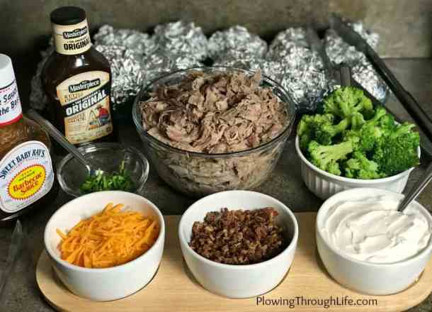 Do you need an easy meal to feed a crowd? Then this Loaded Baked Potato or taco bar recipe is a great option! The DIY loaded potatoes are perfect for a group of friends or for a family gathering. A baked potato bar allows each person to top their potato the way they like it! Make or buy pulled pork, offer a few toppings and you've got an easy meal that will please a variety of palates!