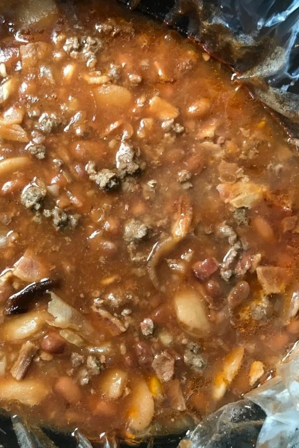 Close up of Meaty Farmhouse Baked Beans with ground beef and bacon in a crock pot