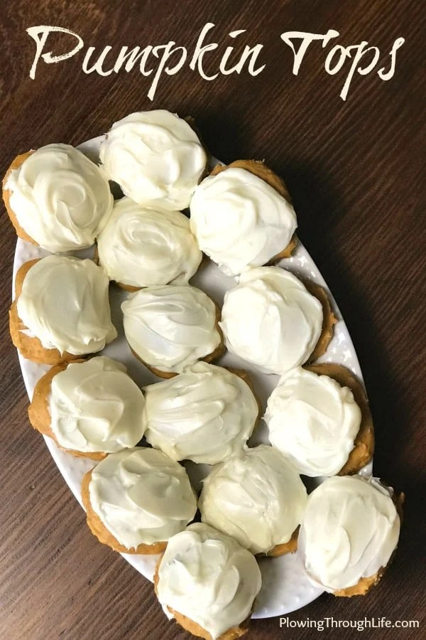 Who wants to try a delicious pumpkin and cream cheese combination?  These pumpkin tops are for you!  They are a delicious cross between a pumpkin cookie and pumpkin muffin.  The cream cheese icing is amazing!  This is the perfect fall dessert! #pumpkincookie #pumpkinrecipe #pumpkinmuffintop