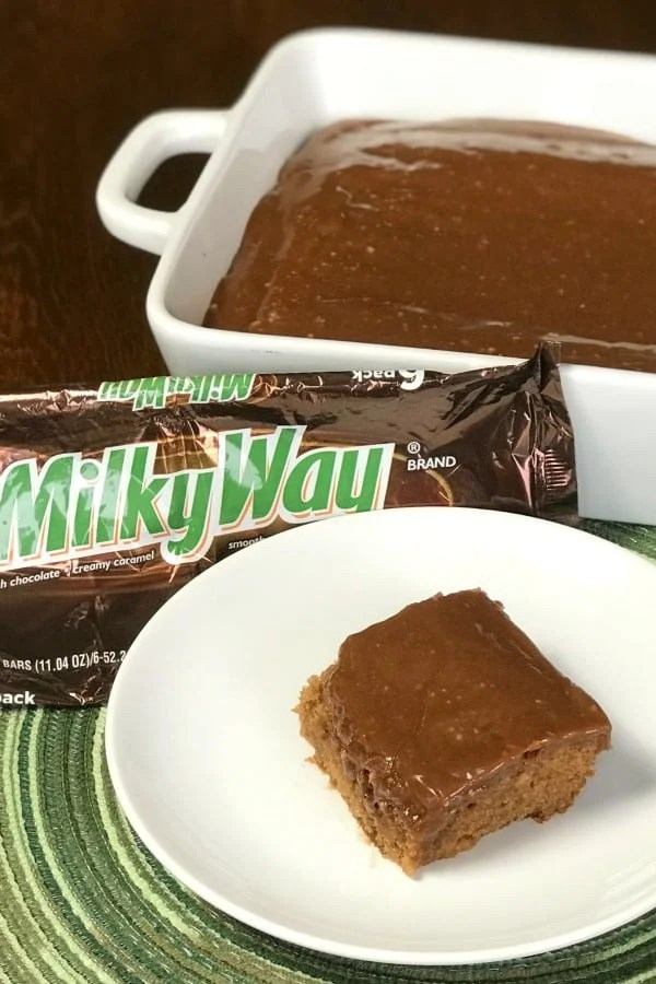 Milky Way Cake is the ultimate dessert for people who LOVE Milky Way candy bars and cake! All of this chocolate and caramel goodness in the Milky Way Cake is the perfect birthday cake or easy homemade cake for any day of the year! #MilkyWay #EasyCake