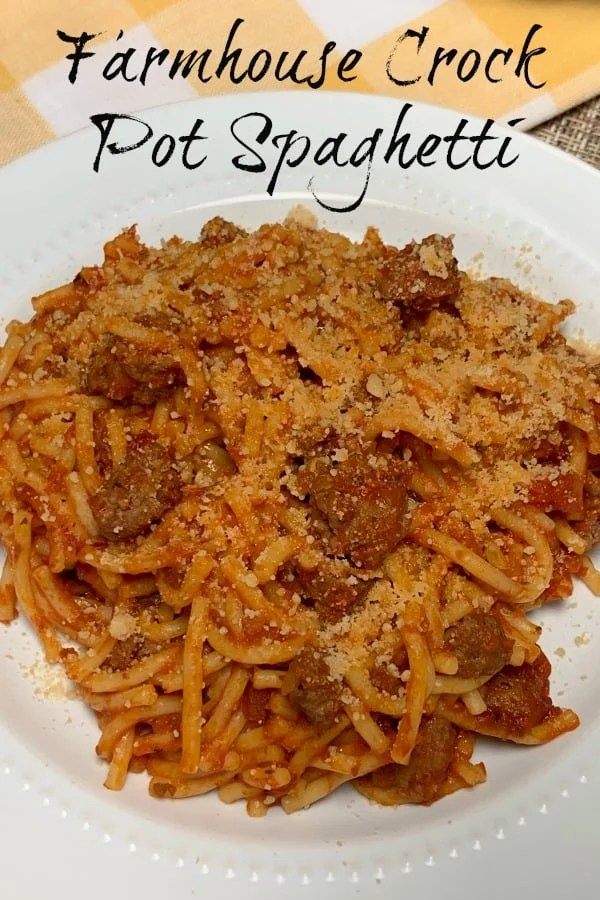 white plate with text, best crock pot recipe for a baked spaghetti flavor
