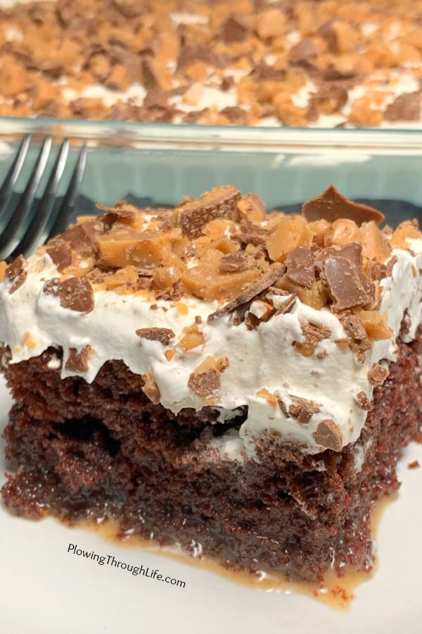 Heath Bar Cake is a rich and creamy butterscotch topped chocolate cake. A box mix plus four extra ingredients make this as good as a bakery cake, but super EASY to make.