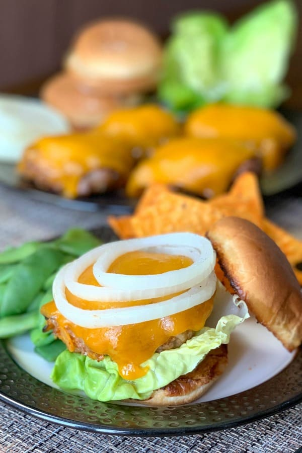 Do you love tacos and hamburgers? Loaded Taco Burgers are a great way to put an easy twist on a classic grilled meal. Ground meat plus four ingredients make an easy meal everyone will love!