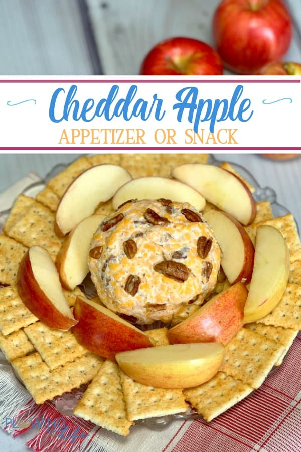 cheddar and cream cheese ball with fresh apples and crackers