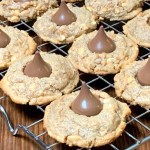 gluten free peanut butter cookies with a chocolate kiss on a cooling rack