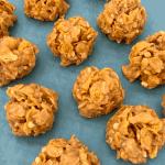 Cornflake balls on a turquoise baking sheet