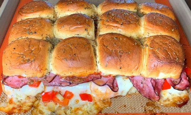 12 Hawaiian rolls made into baked roast beef sliders