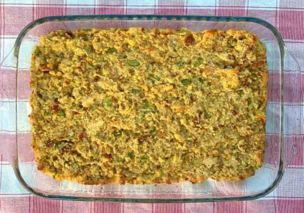 9 x 13 pan of cornbread stuffing on a red plaid napkin