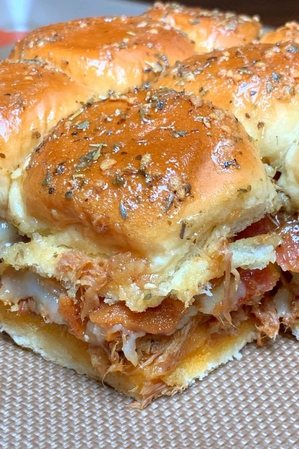 Easy pulled pork sliders glazed with brown sugar, butter and herbs